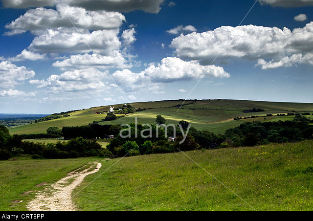 View from Wolstonbury Hill, South Downs National Park, Sussex, towards Jack and Jill windmills
