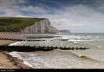 Beach in front of the Seven Sisters chalk cliffs at Cuckmere Haven, East Sussex, England, UK