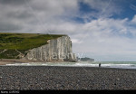 Lovers on the beach in front of Seven Sisters chalk cliffs at Cuckmere Haven, East Sussex, England