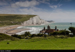 Coast Guard cottages in front of the Seven Sisters chalk cliffs at Cuckmere Haven, East Sussex, England