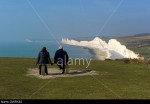 Admiring the view from the hill above Birling Gap towards Sevens Sisters and Seaford Head on the Sussex coast, England