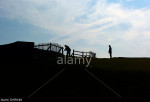 Mending fences on the cliff top at Belle Tout lighthouse, near Beachy Head, Sussex, UK